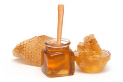 Honey and Honeycomb in the glass Royalty Free Stock Image