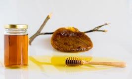 Honey with Honeycomb. Honey and Honeycomb on white background Royalty Free Stock Images