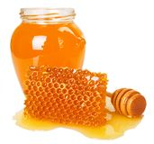 Honey with honeycomb on white background royalty free stock images