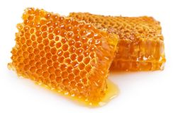Honey with honeycomb on white background royalty free stock photos