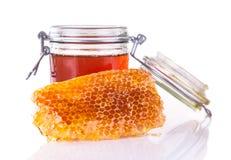 Honey with honeycomb, isolated on white background Stock Photo