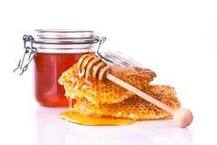 Honey with honeycomb, isolated on white background Royalty Free Stock Images