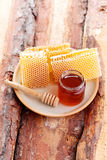 Honey with honeycomb Stock Images