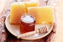 Honey with honeycomb Stock Image