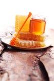 Honey with honeycomb Stock Photography