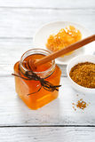 Honey, honeycomb and pollen Stock Photo