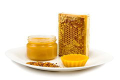 Honey, honeycomb and pollen Royalty Free Stock Photo