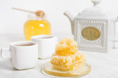 Honey with honeycomb and tea Royalty Free Stock Images