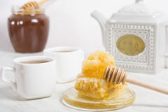 Honey with honeycomb and tea Stock Photo