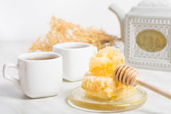 Honey with honeycomb and tea Stock Photography
