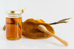 Honey with Honeycomb. Honey and Honeycomb on white background Royalty Free Stock Images