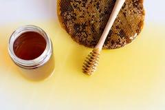 Honey with Honeycomb. Honey and Honeycomb on white background Royalty Free Stock Photography
