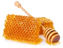 Honey with honeycomb on white background stock photography