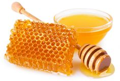 Honey with honeycomb on white background royalty free stock photography