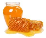 Honey with honeycomb on white background stock photos