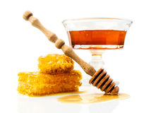 Honey with honeycomb and wooden dipper Royalty Free Stock Images