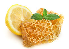 Honey honeycombs with lemon Royalty Free Stock Photography