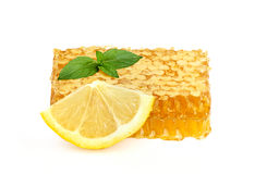 Honey in honeycombs with lemon and mint. Stock Photography