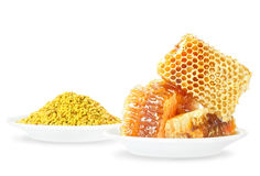 Honey honeycombs and pollen Stock Photos
