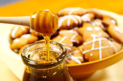 Honey and honeycookies. Detail of Honey and honeycookies Royalty Free Stock Photos