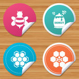 Honey icon. Honeycomb cells with bees symbol. Round stickers or website banners. Honey icon. Honeycomb cells with bees symbol. Sweet natural food signs. Circle royalty free illustration