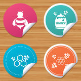 Honey icon. Honeycomb cells with bees symbol. Stock Image