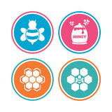 Honey icon. Honeycomb cells with bees symbol. Stock Photos