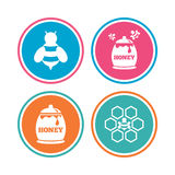 Honey icon. Honeycomb cells with bees symbol. Royalty Free Stock Image
