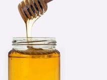 Honey isolated on white. Jar, honey dipper. Royalty Free Stock Photos