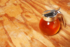 Honey Jar. Against wooden background royalty free stock photo