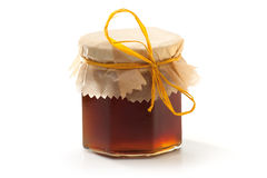 Honey Jar. Dark Honey Jar  on white background Royalty Free Stock Image