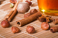 Honey jar and all sorts of nuts. On bamboo mat Royalty Free Stock Images