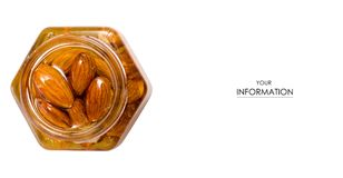 A honey jar with almonds nuts pattern. On a white background isolation Royalty Free Stock Photography