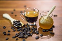 Honey Jar And Coffee Cup And Coffee Beans Stock Photo
