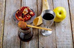 Honey jar with apples Rosh Hashana hebrew religious holiday. Shofar, honey and pomegranate royalty free stock images