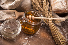 Honey jar and breat Royalty Free Stock Photography