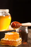Honey in jar and bunch of dry lavender Royalty Free Stock Images
