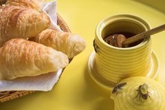Honey jar with croissants Royalty Free Stock Photo