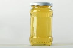 Honey Jar Curiosidad de la miel en el tarro y la cera de cristal de los panales Imagen de archivo libre de regalías