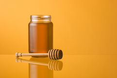 Honey jar and dipper Royalty Free Stock Photo