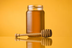 Honey jar and dipper Stock Image