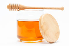Honey in jar with dipper Royalty Free Stock Photos