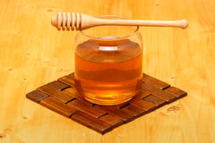 Honey in jar with dipper Royalty Free Stock Images