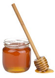 Honey in jar and dipper isolated Stock Photo