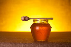 Honey jar with dipper Stock Images