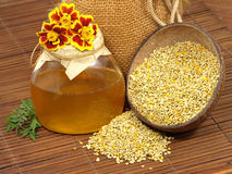 Honey jar, flowers and  pollen. Royalty Free Stock Photography