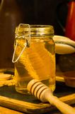 Honey with honey comb in a jar. Honey in a jar with honey comb inside Stock Image
