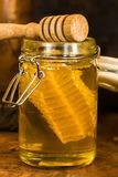 Honey with honey comb in a jar. Honey in a jar with honey comb inside Stock Photo