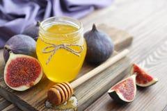 Honey in jar with honey dipper Stock Image