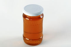 Honey jar. Honey tidbit in glass jar and honeycombs wax. Royalty Free Stock Photos